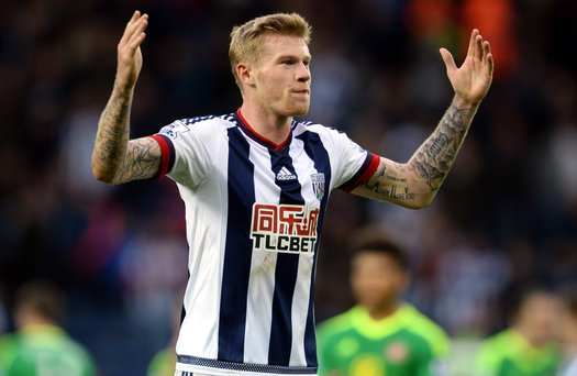 James McClean in action for West Brom; and (right) with fiancee Erin Connor