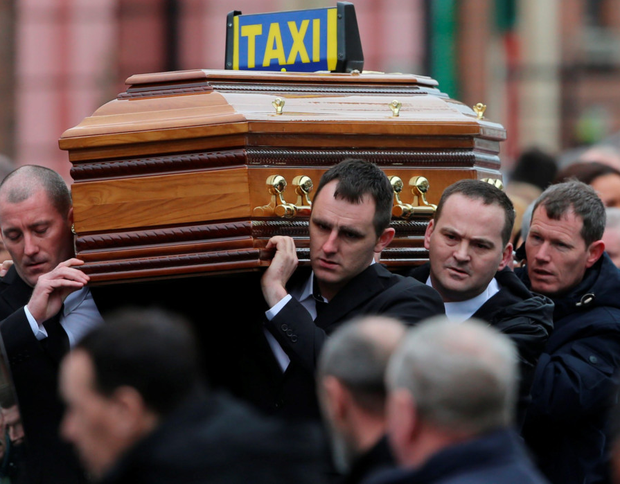 Eddie Hutch snr's coffin is carried into Our Lady of Lourdes Church