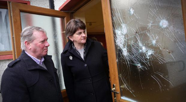 Arlene Foster examines the damage with worshipful master William Ross