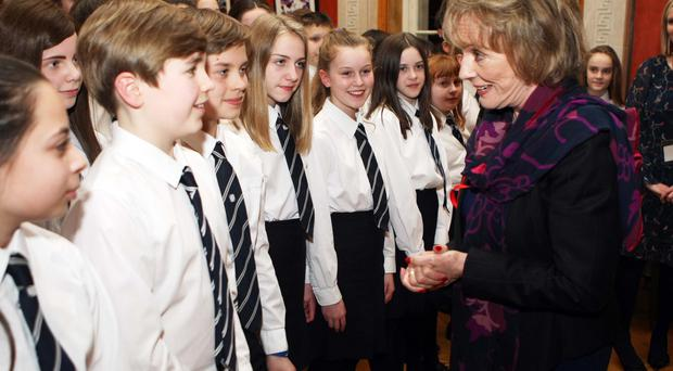 Esther Rantzen with the Methodist College choir during her visit to Belfast yesterday