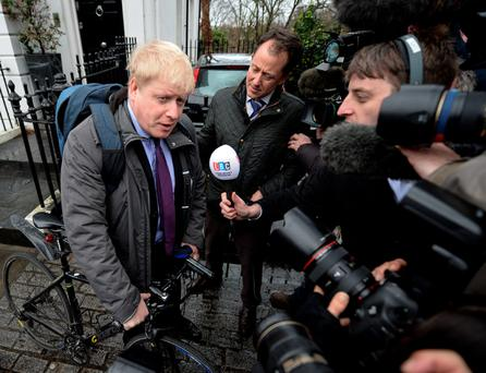 Boris Johnson talks to the media
