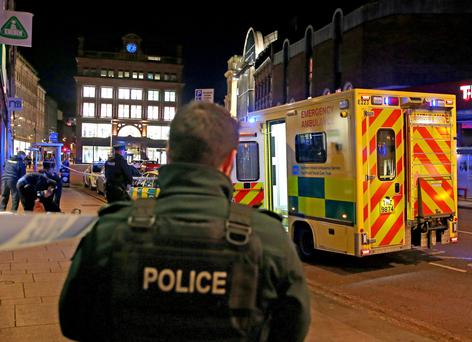 Emergency services attend the scene on High Street in Belfast after a homeless man was found dead last night
