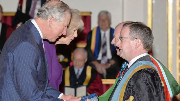 The Prince of Wales with Professor Patrick Johnston of Queen's University Belfast at the presentation of The Queen's Anniversary Prizes for Higher and Further Education