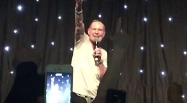 Paul Gascoigne salutes fans on stage in Irvine