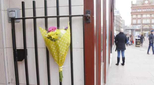 Flowers laid at the spot in High Street where a homeless man died