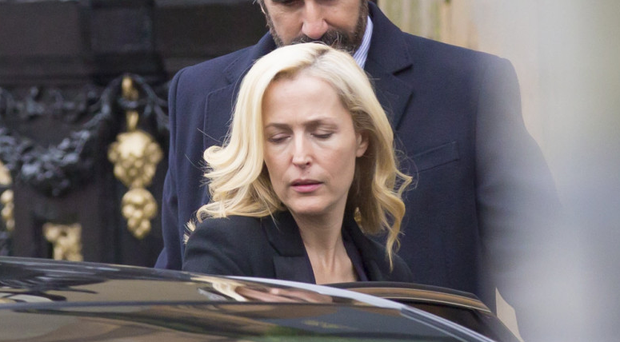 Gillian Anderson and John Lynch filming The Fall outside the Merchant Hotel in Belfast city centre