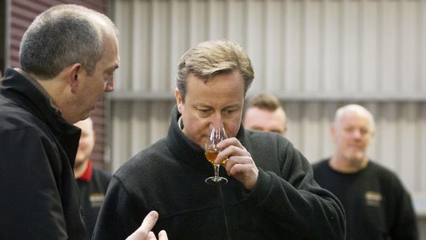 Prime Minister David Cameron smells a dram of whiskey at the Bushmills distillery in Co Antrim