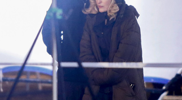 The Fall star Gillian Anderson wraps up against the cold while filming in Little Donegall Street yesterday