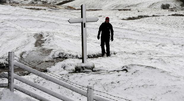 A walker makes their way through snow in Buxton, Derbyshire, with forecasters warning of more to come