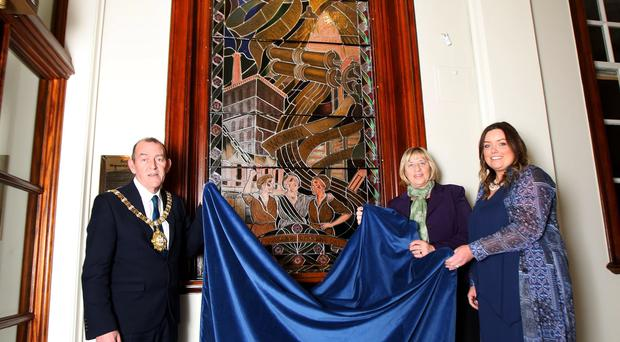 Belfast Lord Mayor Arder Carson with chair and deputy chair of the women's steering group, councillors Deidre Hargey and Aileen Graham, unveiling the new stained glass window