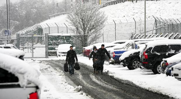 Passengers make their way through the snow to Leeds Bradford Airport