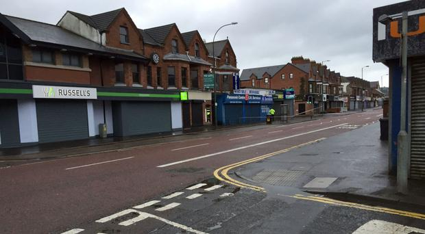 Police seal off a large area after a device exploded under a car in east Belfast, leaving a man injured