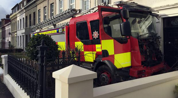 The fire engine was driven into cars and houses in Larne