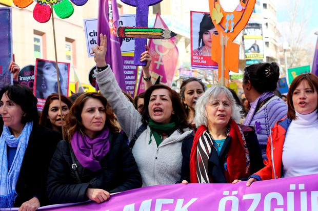 Turkish women shout slogans during a demonstration marking International Women's Day in Ankara