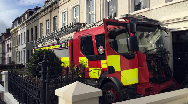The fire engine was allegedly stolen and driven into cars and houses in Larne