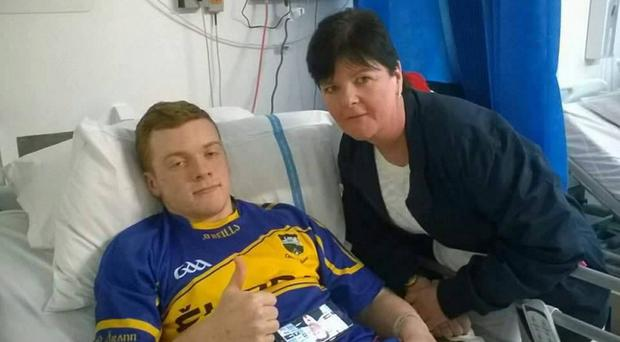 GAA player Ordhran McKenna with his teacher Donna Tohill from St Mary's Grammar School