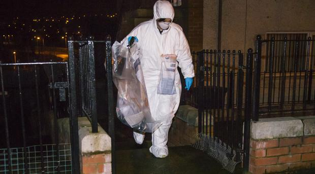 Police investigating a bomb attack on a prison officer have searched a house in Belfast