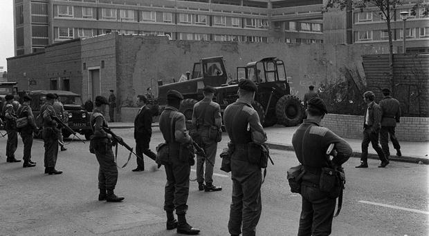Troops line Divis Street, Belfast, during the Troubles
