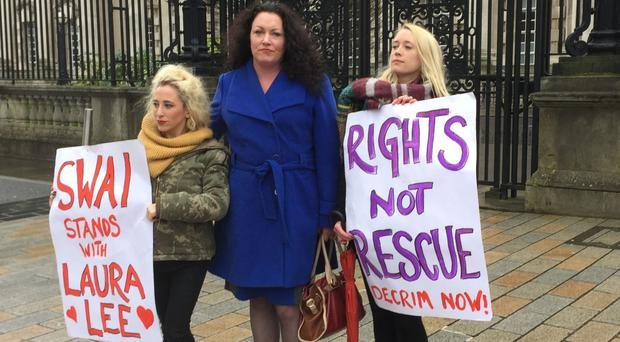 Sex worker Laura Lee, centre, is leading a legal bid to overturn the ban on paying for sex in Northern Ireland
