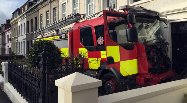 A pensioner and teenager were charged with stealing a fire engine and embarking on a drive of destruction
