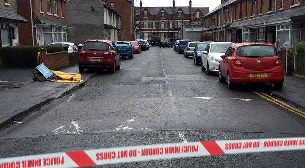 The van, centre top, under which the device exploded in east Belfast