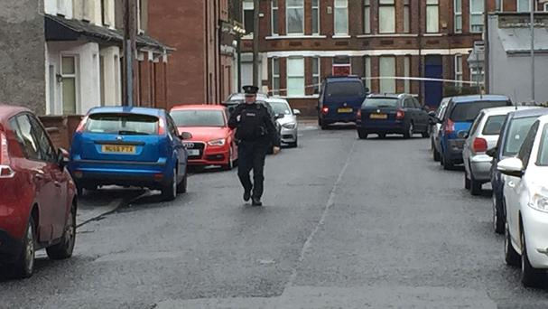 The van (centre, top) under which a device exploded in east Belfast, injuring a prison officer