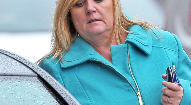 Ann Marie Daye, who admitted stealing from two west Belfast community organisations, leaves Belfast's Laganside Courts yesterday