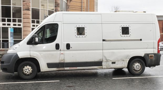 The prison van containing Christopher Robinson is driven from court