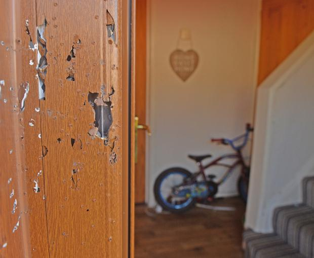 Damage caused to door of the house in the shooting