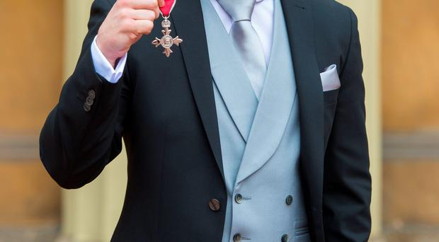 Carl Frampton with his MBE which was presented by the Duke of Cambridge