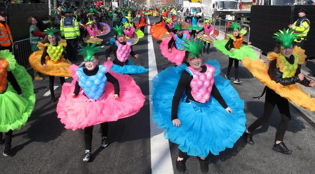 Performers parade down O'Connell Street on St Patrick's Day in Dublin (AP)