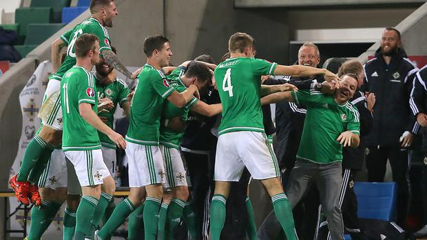 Northern Ireland celebrate one of the goals that helped them book their ticket to France