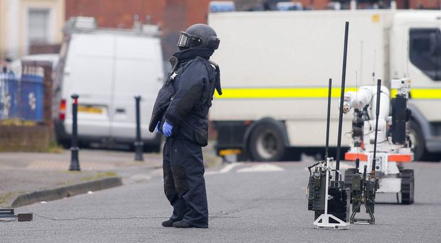 bomb disposal officer at the scene of an explosion in Sheridan Street in north Belfast