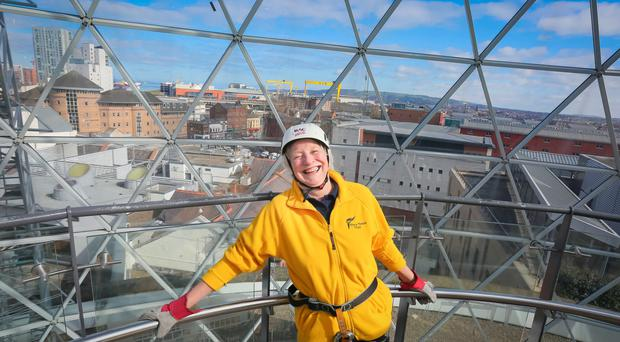 Dame Mary Peters abseils 147 feet from the viewing gallery under the dome in Victoria Square