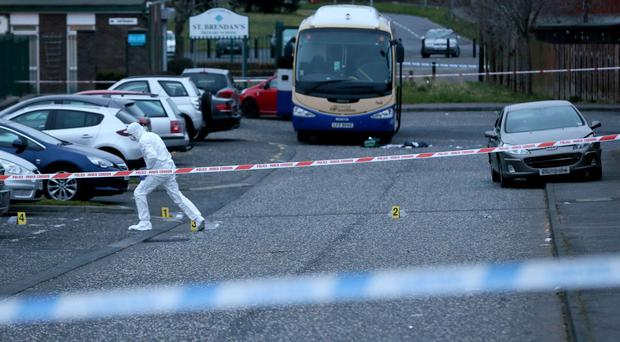 A police forensic officer at the scene of a shooting near a primary school in the Moyraverty area of Craigavon, Co Armagh