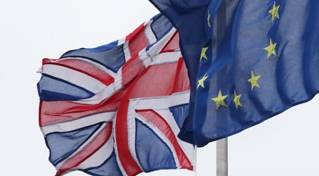Northern Ireland's economy would be hit harder by a Brexit than Britain's, partly because of its land border with the Republic, according to a new report