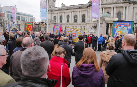 The vigil for murdered prison officer Adrian Ismay at Belfast City Hall yesterday