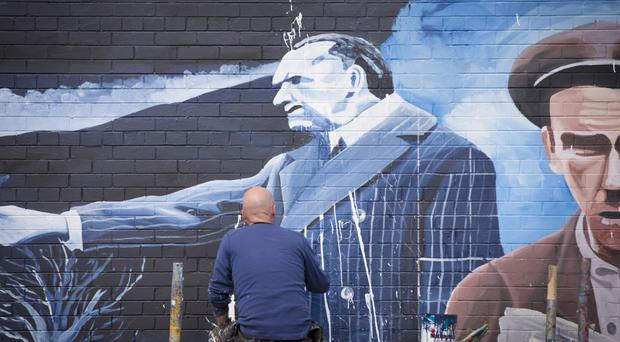 The vandalised Edward Carson mural on the Falls Road