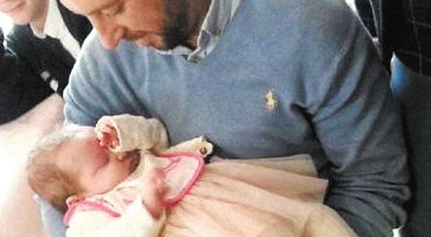 Davitt Walsh with little Rioghnach-Ann