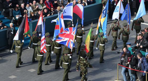 Flags on display as the largest military parade in the history of the Irish Republic passes the GPO as part of the 1916 Easter Rising centenary commemorations in Dublin