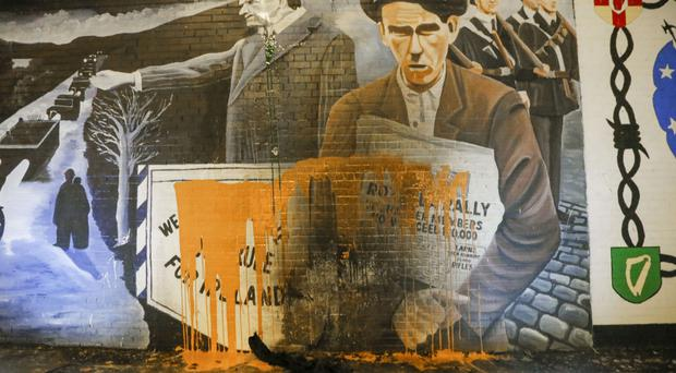 The Edward Carson mural covered in paint at the International Wall