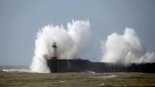 Waves batter the lighthouse at Newhaven in East Sussex, where Storm Katie brought high winds and choppy waters