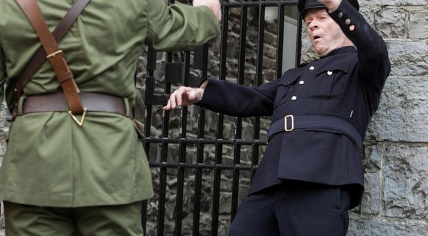 James McMahon plays an RIC officer getting shot by an Irish Volunteer during the re-enactment at Dublin Castle