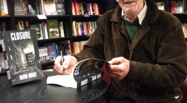Author David Magee at a book signing for his first novel Closure