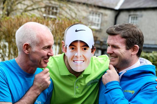 RTE's Ray D'Arcy joins 'Rory McIlroy' and former Ireland rugby player Gordon D'Arcy at the K Club yesterday