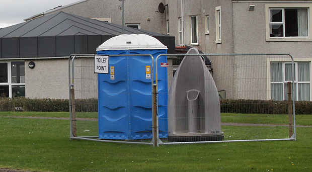 The temporary public toilets at the junction with the town's Causeway Street, close to Royal Portrush Golf Club
