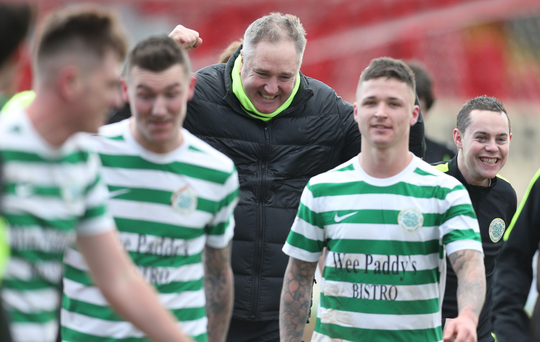 Lurgan Celtic boss Colin Malone celebrates with his players after getting the better of Portadown in the last round