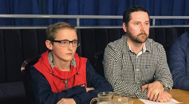 Christian King, 12, with his father George King at a press conference in south Belfast
