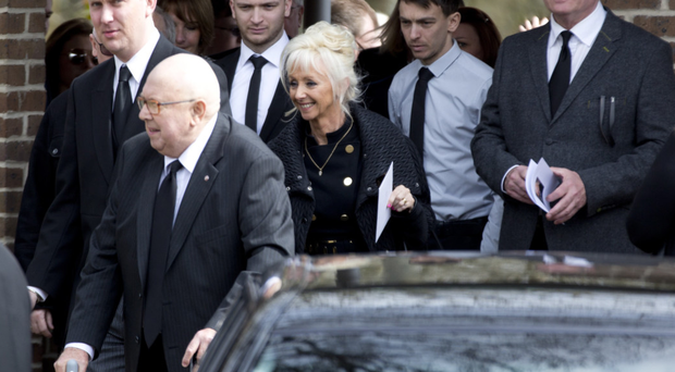 Debbie McGee leaves the private funeral service for her husband Paul Daniels