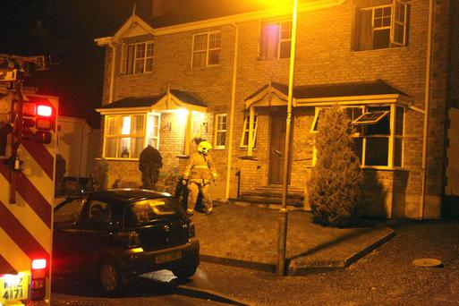 Fire officers at the scene of the blaze in Downpatrick
